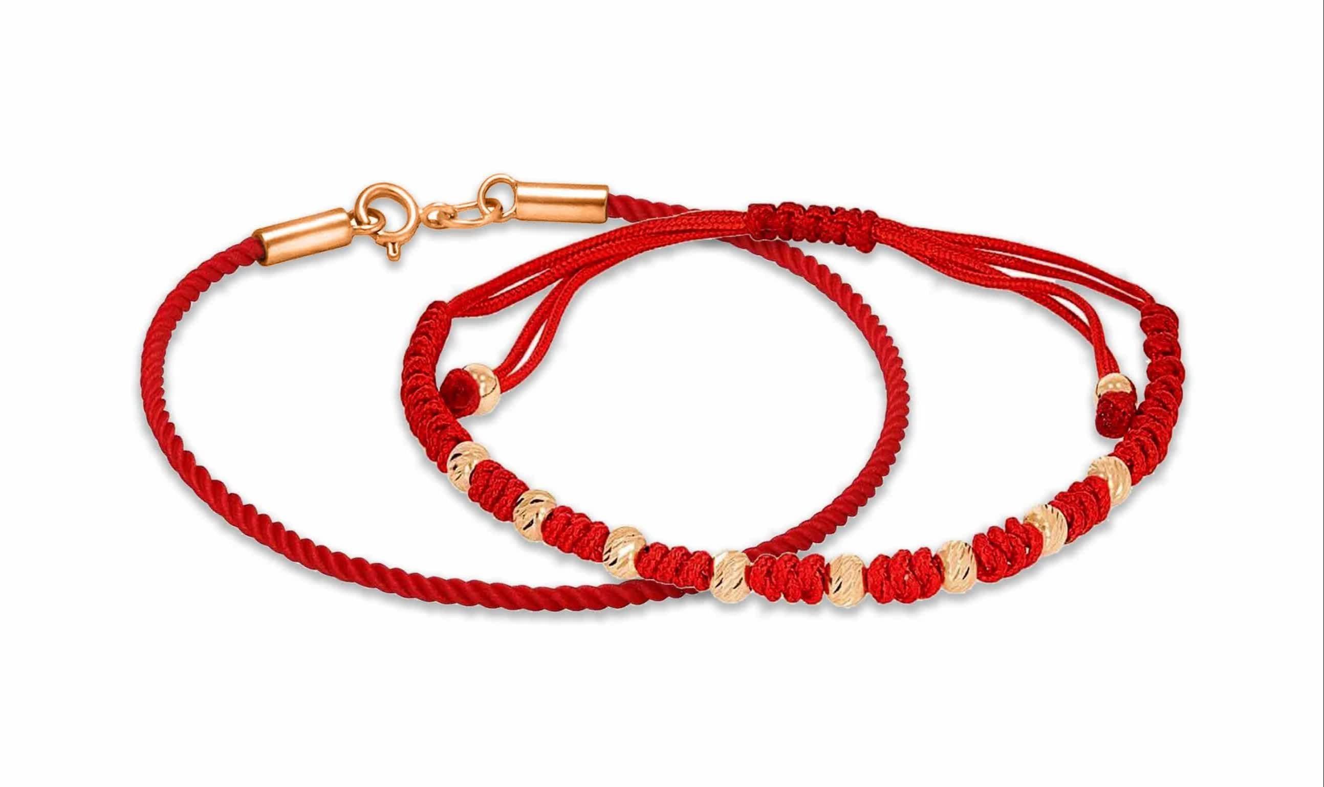 Красная нить с золотыми вставками и золотой застежкой, на руку.